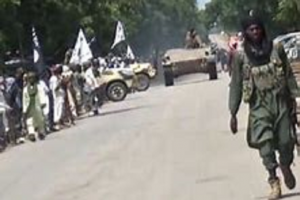 a boko haram fighter on a road