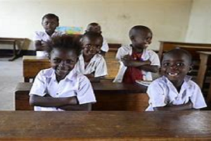 children sitting on bench tables at school